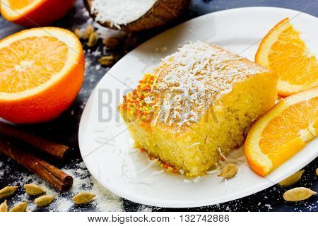 Basbousa (Namoora) - Egyptian semolina cake with orange sugar syrup and spices selective focus
