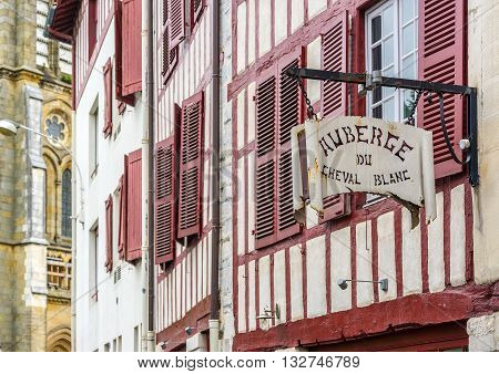 Bayonne, France - May 21, 2016:  Hostel signboard in a facade of typical building of Aquitaine. Bayonne, France.