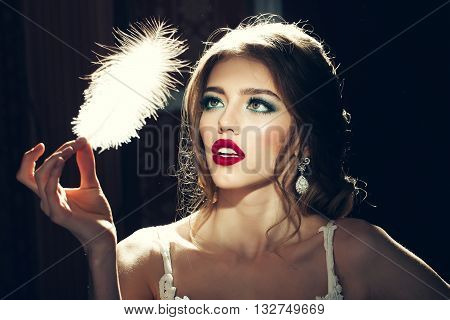Pretty Woman With Feather Closeup