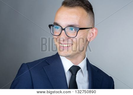 Smiling Young Guy In Glasses
