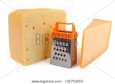 Pieces of huge cheeses of different tastes and tiny metal grate for preparing grated cheese isolated on white