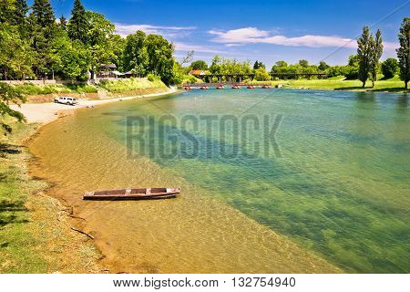 Korana river beach and wooden boat town of Karlovac Croatia