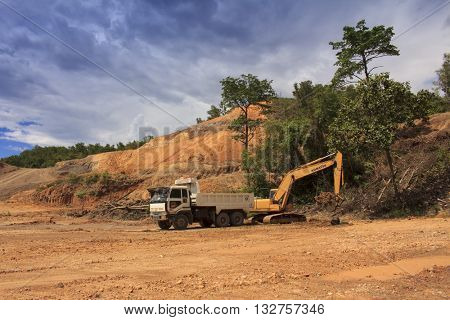 KOTA KINABALU, MALAYSIA - JUNE 03 2016: Deforestation. Environmental damage to rainforest in Borneo, nature destroyed for oil palm plantations and construction.