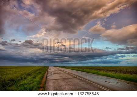 exciting clouds over the road after rain