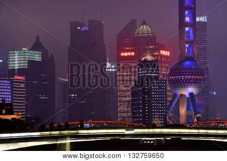 SHANGHAI, CHINA - MARCH 19: Pudong district night view from Suzhou Creek on March 19, 2016 in Shanghai, China. Pudong is a district of Shanghai, located east of the Huangpu River.