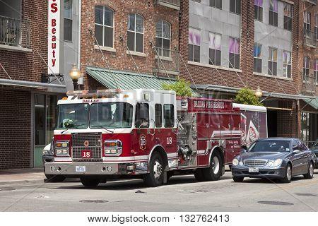 DALLAS USA - APR 7: Red fire truck in the city street of Dallas. April 7 2016 in Dallas Texas United States