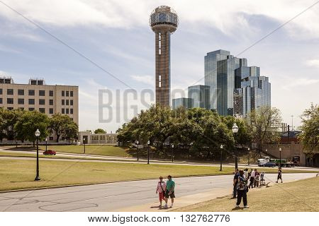 DALLAS TX USA - APR 7 2016: Tourists at the spot where President John F. Kennedy was assassinated in Dallas Texas United States