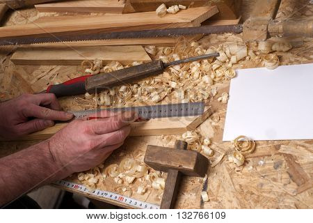 Carpenter Working. Carpenter Tools On Wooden Table With Sawdust. Carpenter Workplace Top View