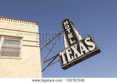 FORT WORTH USA - APR 6: Hotel Texas sign in the Fort Worth Stockyards historic district. April 6 2016 in Fort Worth Texas USA