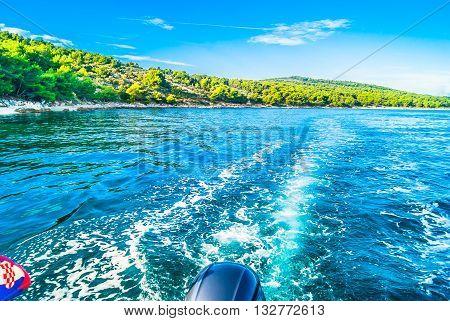 Touristic destination Croatia - coastline view from boat in summer time, Adriatic sea.