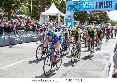 MELBOURNE, AUSTRALIA - FEBRUARY 1: The peloton cross the finish line for the last lap in the Cadel Evans Great Ocean Road race