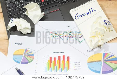 Sale analysis report show result of growth success charts and graphs on document paperwork with laptop crumpled paper idea