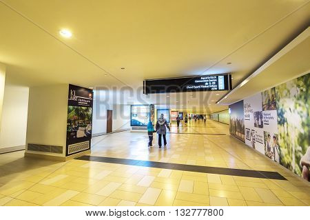 KUALA LUMPUR MALAYSIA - NOVEMBER 02 2014: Tunnel to Aquaria KLCC in Petronas Twin Towers. Suria KLCC is one of the largest shopping malls in Malaysia