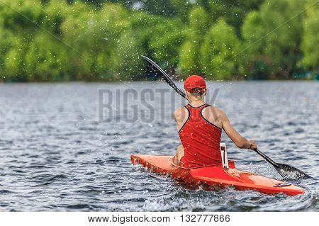 man athlete canoeists during sprint race for rowing competitions