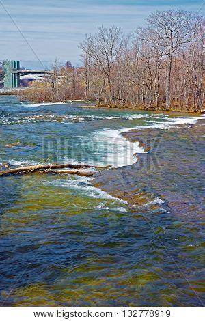 Thresholds In Niagara River And Rainbow Bridge On The Background