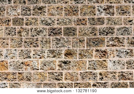 Background from an old natural tuff stone wall