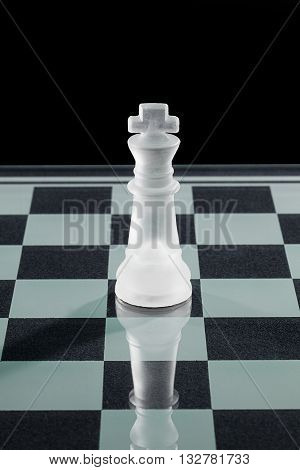 crystal chess king isolated on a black background