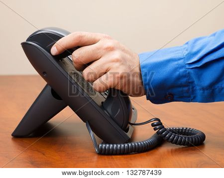Close Up Image Of A Person Holding Telephone Reciever