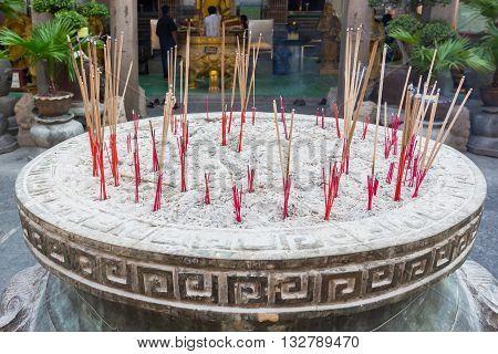 BANGKOK THAILAND -7 MAY 2016 : Incense burner and Golden buddha statue in Wat Kalayanamitr Bangkok, Thailand