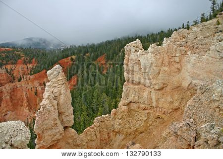 low clouds advance over sandstone cliffs in Utah