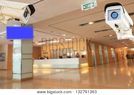 The CCTV Security Camera operating in hospital blur background. poster