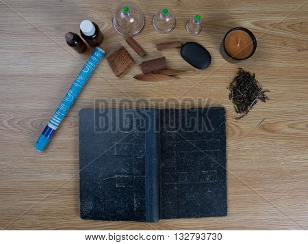 Acupuncture Needles, Moxa Sticks, Cup, Oil, Tcm Traditional Chinese Medicine Concept Photo