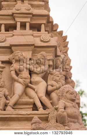 Chettinad India - October 16 2013: Detail of Shiva temple gopuram in Thirumayam. Man copulates with woman in standing position.
