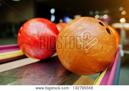 Two Colored Bowling Balls Of Number 13 And 12