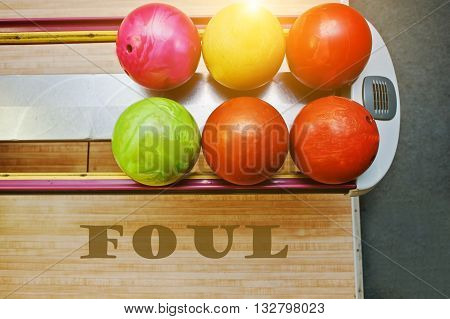 The word foul background bowling balls at alley