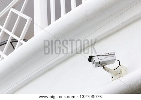 The CCTV Security Camera operating in the white terrace background special camera two lens.