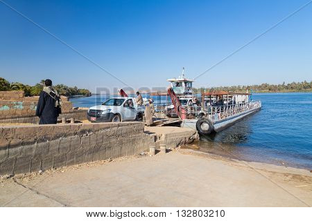 NILE, EGYPT - FEBRUARY 9, 2016: Cars driving of the ferry over the Nile.