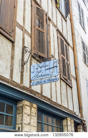 Bayonne France - May 21 2016: Luthiers signboard in a facade of typical building of Aquitaine. Bayonne France.