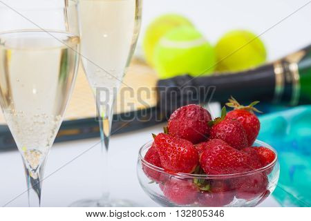 Strawberries and glasses with champagne during Wimbledon tournament