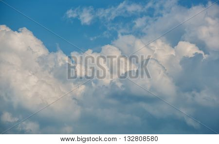 Great billowing clouds against a blue sky.