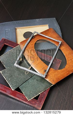 Vintage photo frames from metal, wood and paper