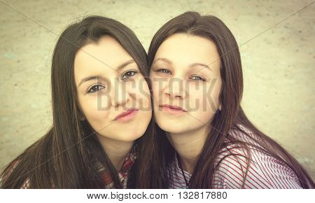 two girls were photographed face to face