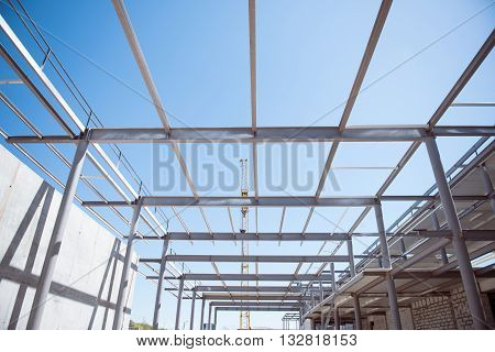 Industrial. Construction works of new industrial building with channel girders, as a background