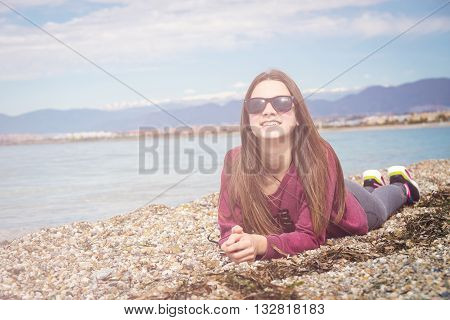 the young girl was photographed lying on the beach