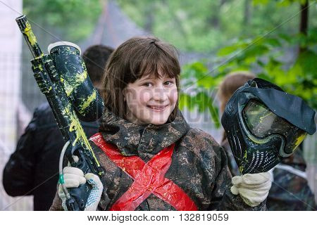 Girl In Camouflage After Paintball Game