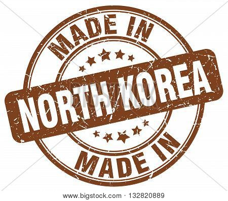 made in North Korea brown round vintage stamp.North Korea stamp.North Korea seal.North Korea tag.North Korea.North Korea sign.North.Korea.North Korea label.stamp.made.in.made in.