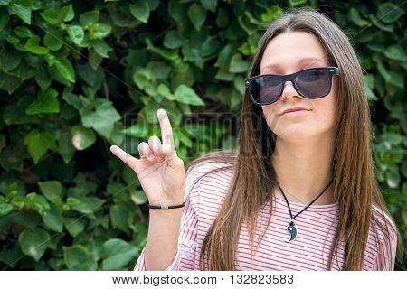 the beautiful young girl in sunglasse was photographed in park