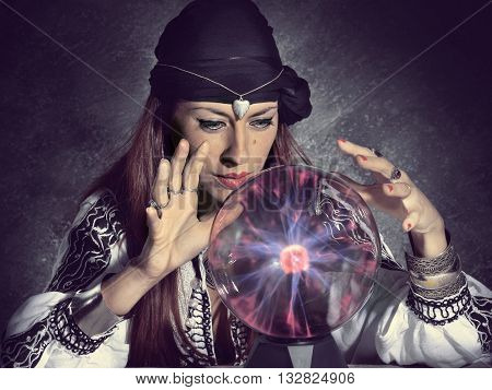 gypsy fortune teller forecast future in crystal ball