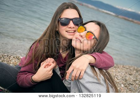 two young beautiful girls were photographed on walk by the sea