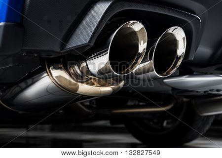 Car detailing series : Closeup of clean car muffler