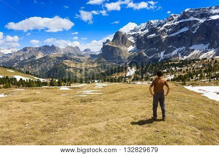Man On Top Of Mountain Looking At The Horizon.