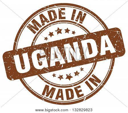 made in Uganda brown round vintage stamp.Uganda stamp.Uganda seal.Uganda tag.Uganda.Uganda sign.Uganda.Uganda label.stamp.made.in.made in.