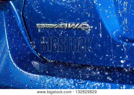 BANGKOK, THAILAND - JUNE 2, 2016 : Water dripping down on symmetrical AWD emblem of all-new Subaru WRX