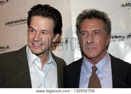 Mark Wahlberg and Dustin Hoffman at the 'A Place Called Home 11th Annual Gala' for the Children at the Beverly Hilton Hotel in Beverly Hills. USA on October 28, 2004.