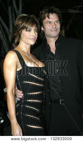 Lisa Rinna and Harry Hamlin at the 2nd Semi Annual Fashion Wire Daily's event NEXT at Mondrian Hotel's SkyBar in West Hollywood, USA on October 25, 2004.