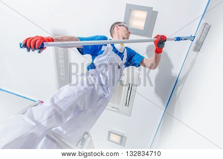 Interior Painting Business. Professional Room Painter at Work. Walls Painting.